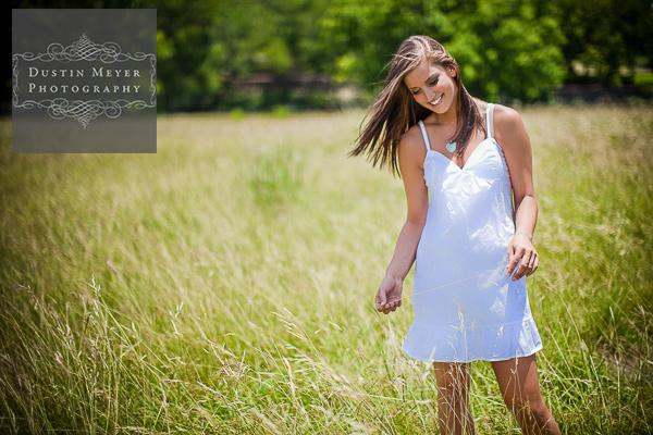 White dress tall grass field senior portraits brunette female