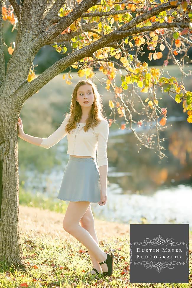 gorgeous female senior portraits blue skirt white button long sleeve shirt blonde curly hair blue eyes senior portraits ideas fashion