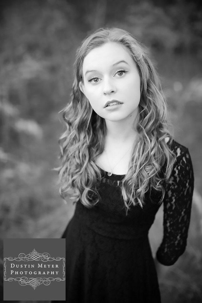 blonde curly hair blue eyes female senior portraits photo photography ideas black lace long sleeve dress