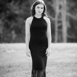 senior portrait ideas, black and white, outdoors, field, grass, black dress